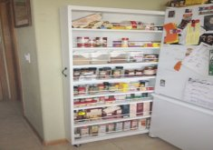Marvelous Kitchen Pantry On Wheels   Furniture. Tall Sliding White Wooden Cabinet With Many Shelves And Wheels  On The Bottom.